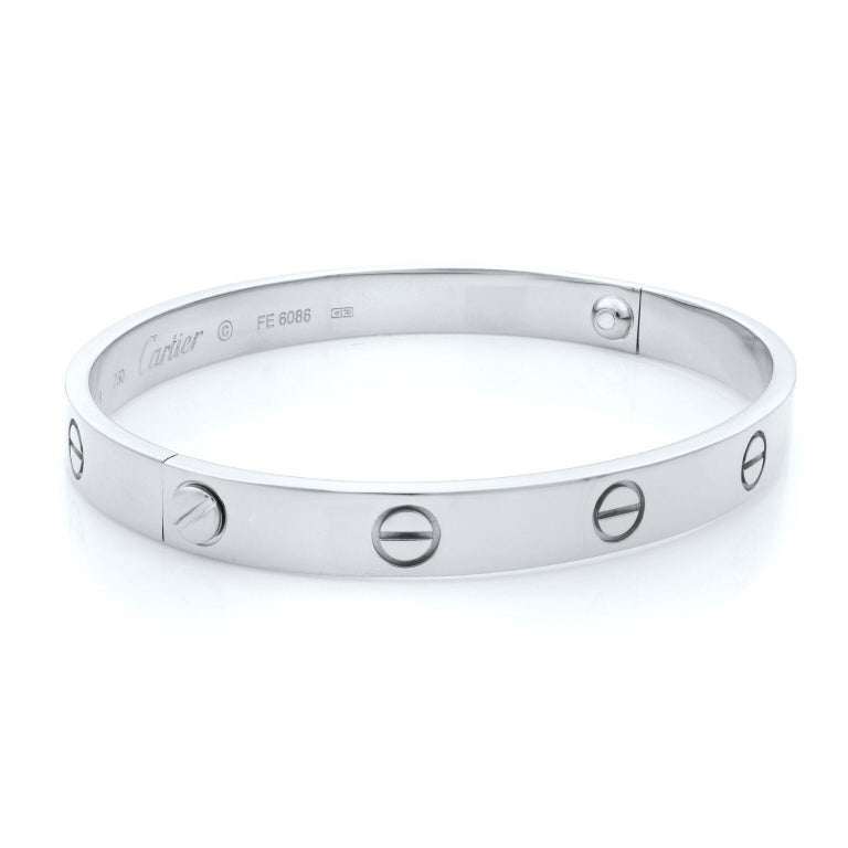 Cartier Love bracelet in 18K white gold. Old screw system. Pre-owned, with old screw style closure. Looks great. Comes with screwdriver, no papers and no box. Size: 18