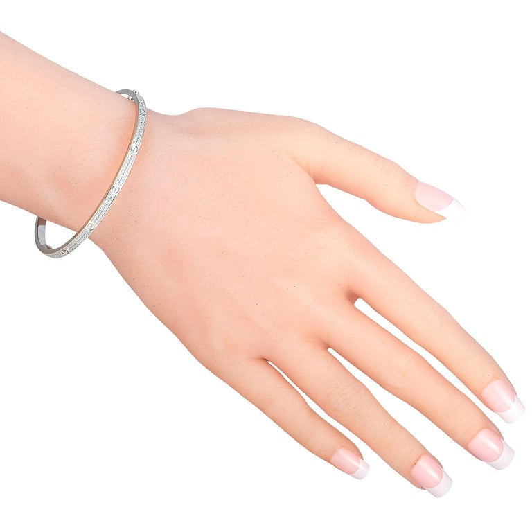 """The Cartier """"LOVE"""" bracelet is made of 18K white gold and embellished with a plethora of diamonds. The bracelet weighs 20.9 grams and measures 7.40"""" in length.  This jewelry piece is offered in estate condition and includes the manufacturer's box."""