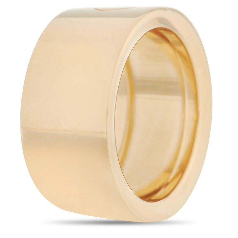 This bold Cartier Love 18K Yellow Gold Screw Ring is a classic Cartier ring. The simple band is made with 18K yellow gold and features the iconic Cartier screw motif in the center of the band. The inside of the band is inscribed with the brand name.