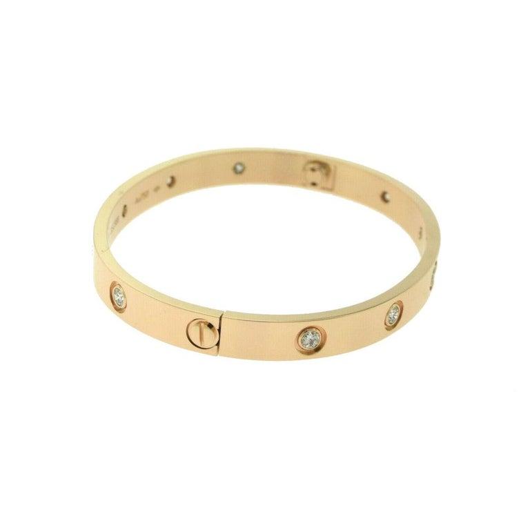 Designer: Cartier  Collection: Love  Style: Bangle Bracelet  Metal: Rose Gold  Metal Purity: 18k  Stone: Round Brilliant Cut Diamonds  Total Carat Weight: 0.96 ct  Bracelet Size: 17 = 17 cm  Hallmarks: 17, Au750 Cartier, Serial No.,  Retail: