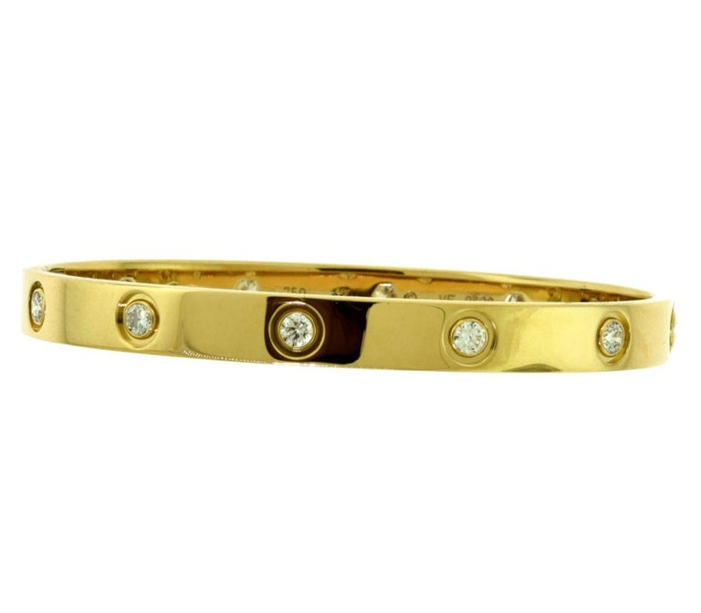 Cartier Love Bracelet 10 Diamond in 18 Karat Yellow Gold In Excellent Condition For Sale In Miami, FL