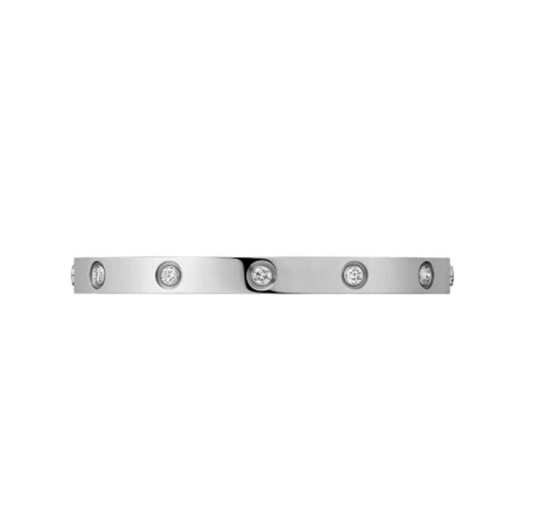 Designer: Cartier  Collection: Love  Style: Bangle Bracelet  Stone: Round Brilliant Cut Diamond  Total Carat Weight: 0.96ct  Metal: White Gold  Metal Purity: 18k  Bracelet Size: 18 = 18 cm  Hallmarks: 18, Au750 Cartier, Serial No.,  Retail: