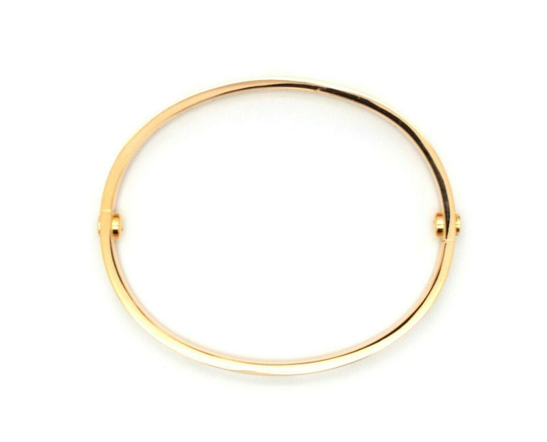 A signature 18k Rose Gold Cartier bracelet from the Love collection. The bracelet is a size 17 and has a gross weight of 33.0 grams. Original box and key included. Pristine condition, shows no scratches or wear. Bracelet is hallmarked Serial # RA