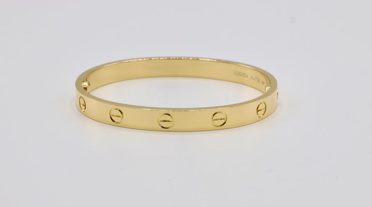 Cartier LOVE Bracelet 18K Yellow Gold Size 16 Box & Papers   Metal: 18K yellow gold Weight: 29.52 grams Size: 16 New screw system  Box, papers, screw driver, travel pouch, cleaning solution included as pictured