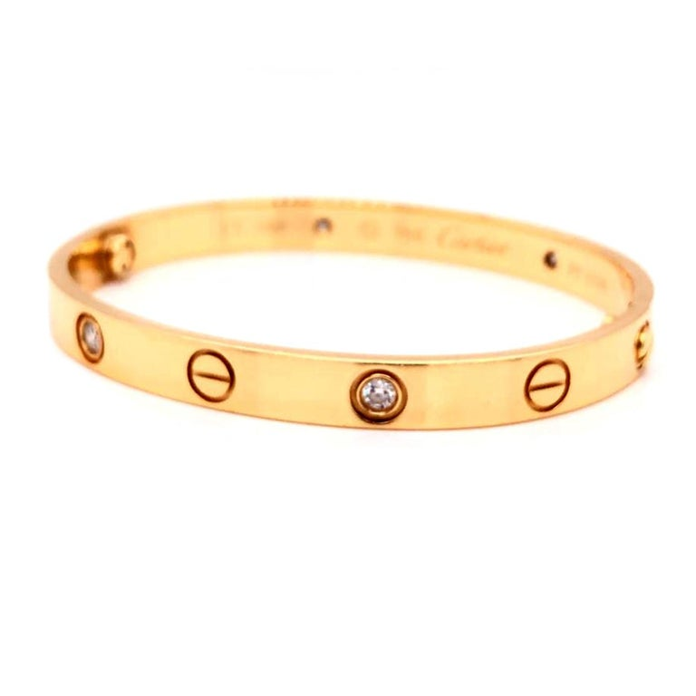 Description: Love bracelet, 18K yellow gold, set with 4 brilliant-cut diamonds totaling 0.42 carats. Sold with a screwdriver. Width: 6.1mm.  About the Collection: A child of 1970s New York, the LOVE collection remains today an iconic symbol of love