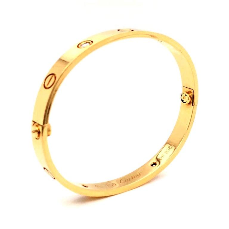 Cartier LOVE Bracelet 18K Yellow Gold 4 Brilliant Cut Diamonds with Screwdriver In Good Condition In Aventura, FL