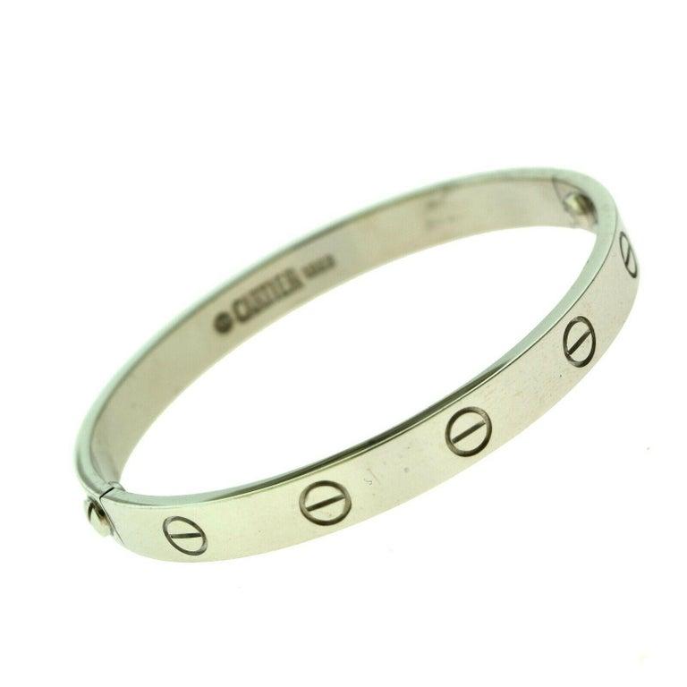Designer: Cartier  Collection: Love  Style: Bangle Bracelet  Metal: White Gold  Metal Purity: 18k  Bracelet Size: 16 = 16 cm  Hallmarks: 16, Au750 Cartier, Serial No.,  Screw System: