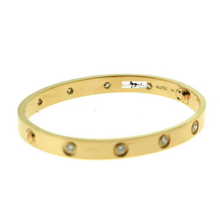 Designer: Cartier  Collection: Love  Style: Bangle Bracelet  Metal: Rose Gold  Metal Purity: 18k  Bracelet Size: 17 = 17 cm  Stones: 10 Round Brilliant Cut Diamonds  Hallmarks: 17, Au750 Cartier, Serial No.,  Screw System: