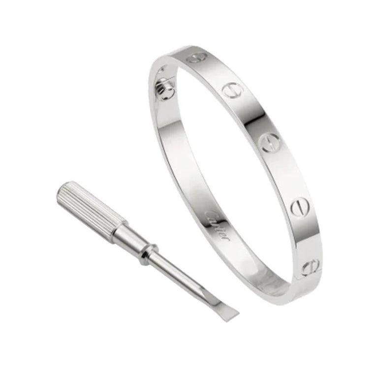 Designer: Cartier  Collection: Love  Style: Bangle Bracelet  Metal: White Gold  Metal Purity: 18k  Bracelet Size: 19 = 19 cm  Hallmarks: 19, Au750 Cartier, Serial No.,  Retail: $6,750 excluding tax.  Includes:  24 Months Brilliance Jewels