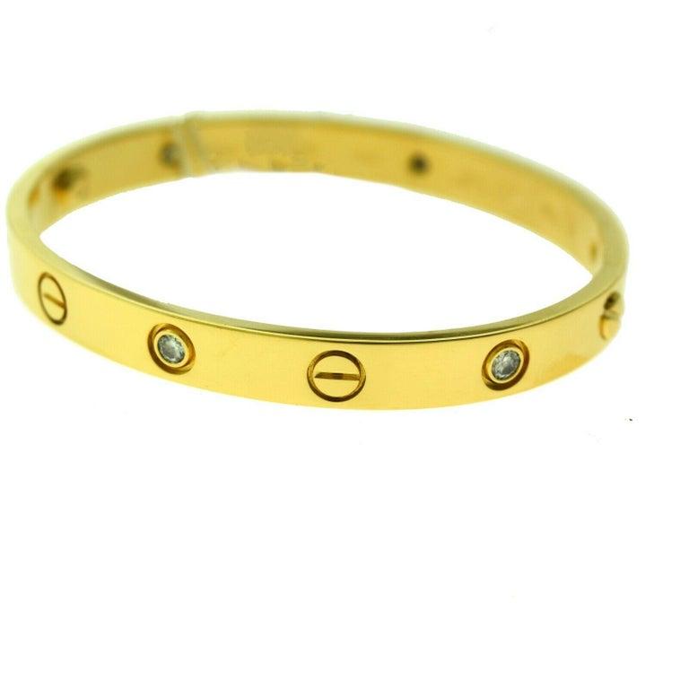 Designer: Cartier  Collection: Love  Style: Bangle Bracelet  Metal: Yellow Gold  Metal Purity: 18k  Bracelet Size: 16 = 16 cm  Stones: 6 Round Brilliant Cut Diamonds  Hallmarks: 16, Au750 Cartier, Serial No., 1998  Screw System: