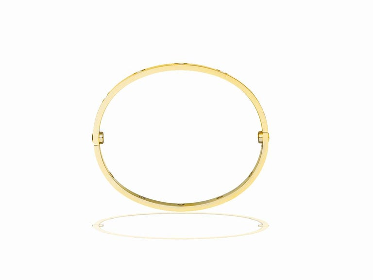 This gorgeous Cartier Love Bracelet is size 16 and in 18k yellow gold.  The bracelet comes with box and papers.  The Love Bracelet (styled L⊝Ve, with the horizontal line inside the letter