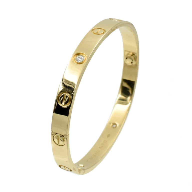 Cartier Love Bracelet set with 4 Brilliant Cut Diamonds total weight approxiamtely 0.42ct.   18K Yellow gold,  Size of the bracelet is 17 and the width is  6.1mm. with new screw system.  Stamped: Cartier  Au750 with BOX472,   ( Retail Value: $10,100