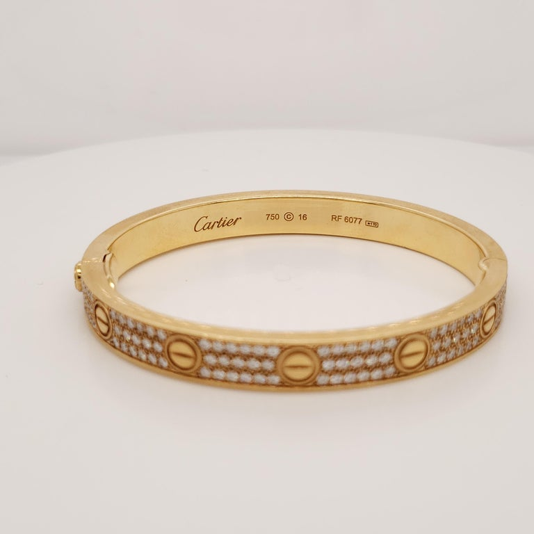 Love bracelet, 18K gold, set with 204 brilliant-cut diamonds totaling 2 carats. Cartier always seeks to perfect the harmony of each one of its creations. Because of this, the carat weight and the number of precious stones can vary slightly from
