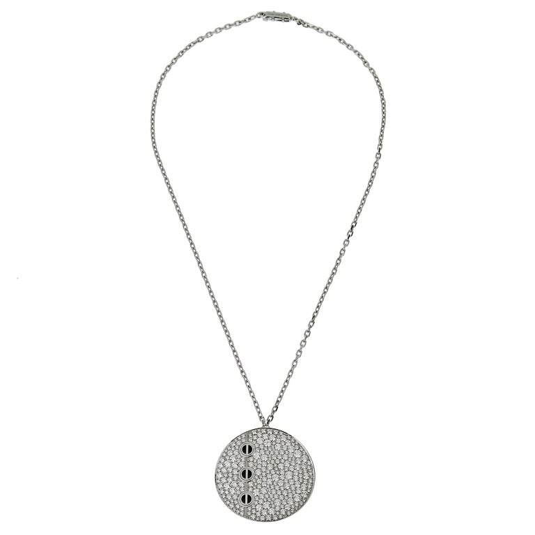 A magnificent special order Cartier Love pendant diamond necklace circa 2000s showcasing over 5ct of the finest original Cartier round brilliant cut diamonds pave set with 3 iconic screw motifs crafted in onyx. The pendant measures 1.37