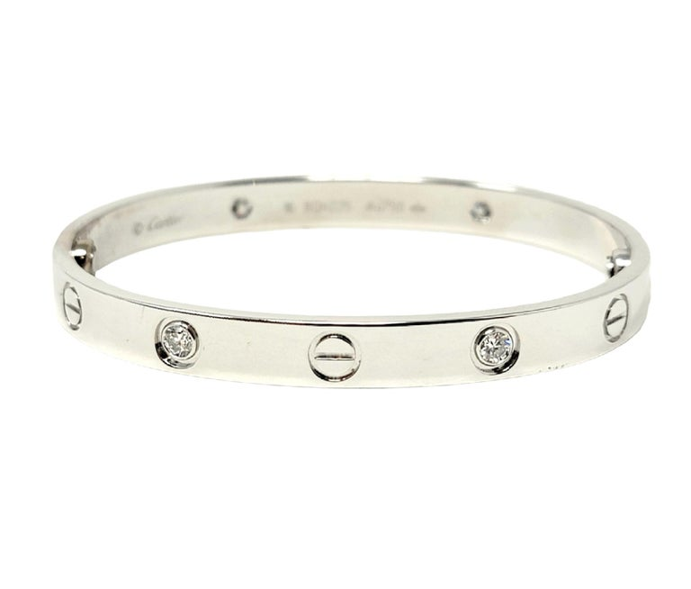 Iconic Love Collection bangle bracelet with diamonds from luxury jeweler, Cartier. Includes box, outer box, and screwdriver. This simple, yet effortlessly timeless piece makes a chic statement on the wrist. With its clean lines, perfect symmetry,