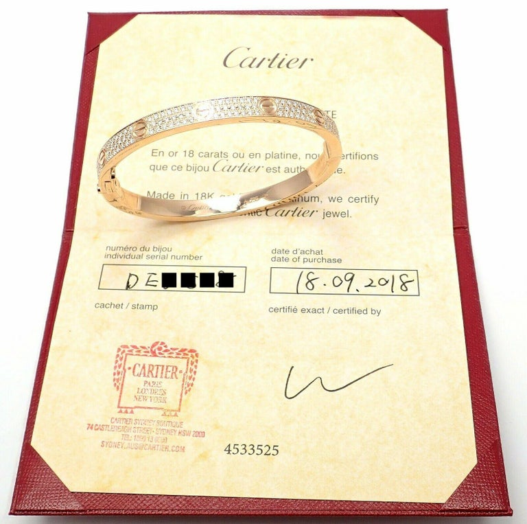 18k Rose Gold Diamond Paved LOVE Bangle Bracelet by Cartier.  SIZE 19.  With 204 brilliant cut VVS1 clarity, E color diamonds totaling 2 carats. This bracelet comes with Cartier box & Cartier certificate of authenticity and a sales receipt. Retail