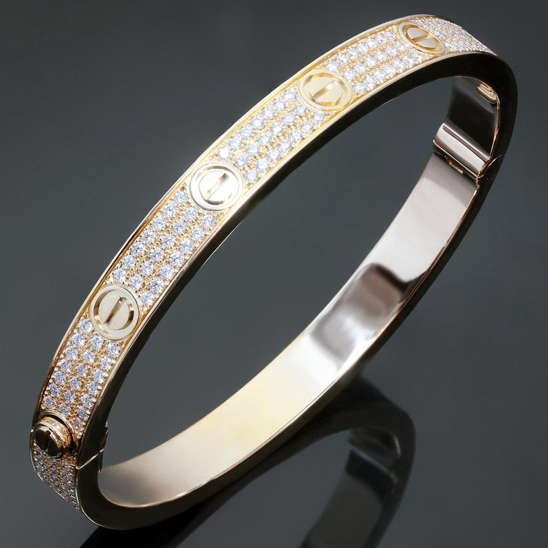 This exquisite Cartier bracelet from the iconic Love collection is crafted in 18k yellow gold and set with 200 brilliant-cut diamonds weighing an estimated 2.00 carats. Made in France circa 2010s. Measurements: 0.25
