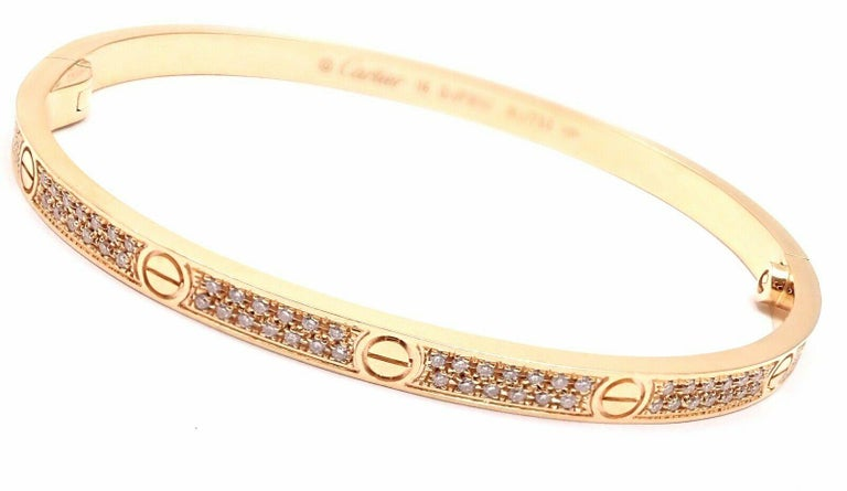 18k Rose Gold Pave Diamond LOVE Small Model Bangle Bracelet by Cartier. SIZE 16.  This bracelet comes with Cartier box. With 177 round brilliant cut diamonds VVS1 clarity, E color total weight approx. .95ct  Details:  Size: 16 Weight: 16.4