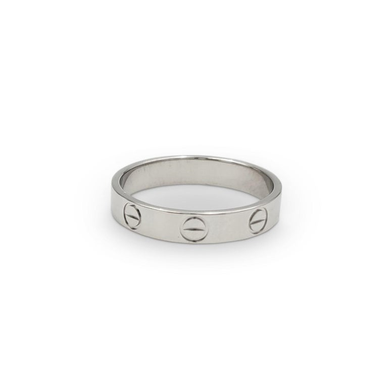Authentic Cartier 'Love' wedding band crafted in platinum. Signed Cartier, 52, PT950, with serial number and hallmark. Ring size 52 (US 6). The band is presented with the original box and papers. CIRCA 2020s.  Ring Size: 52 (US 6) Box: Yes Papers: