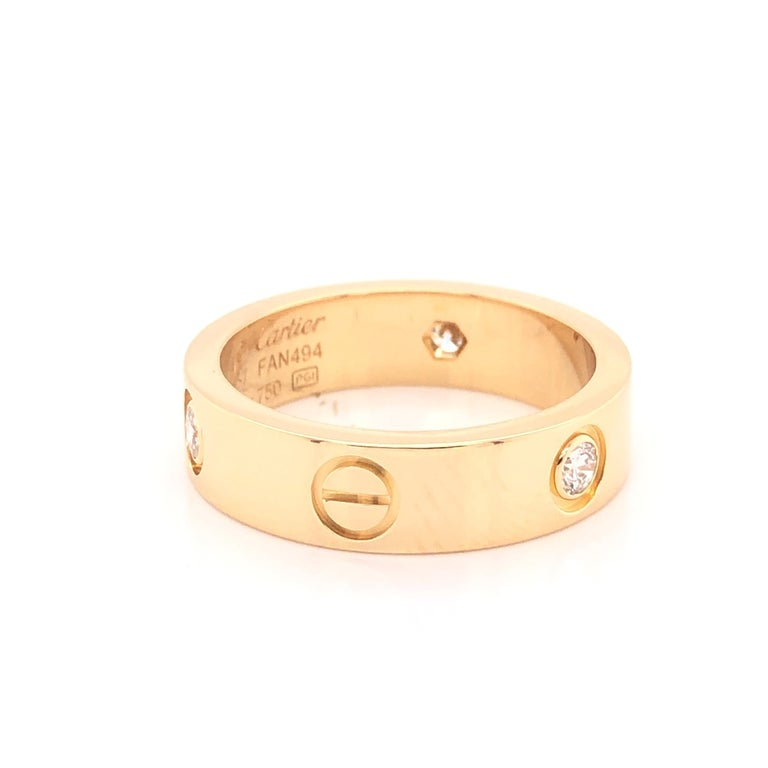 Love ring, 18K yellow gold, set with 3 brilliant-cut diamonds totaling 0.22 carats.  The ring is a size 57 U.S. size 8 with serial FAN---. Ring is fully hallmarked by designer