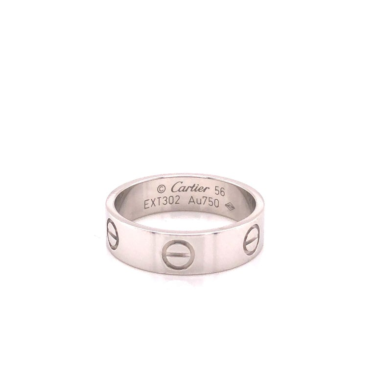 Cartier Love ring in 18K white gold. The ring is a size 56 U.S. size 7.5 with serial EXT---. Ring is fully hallmarked by designer