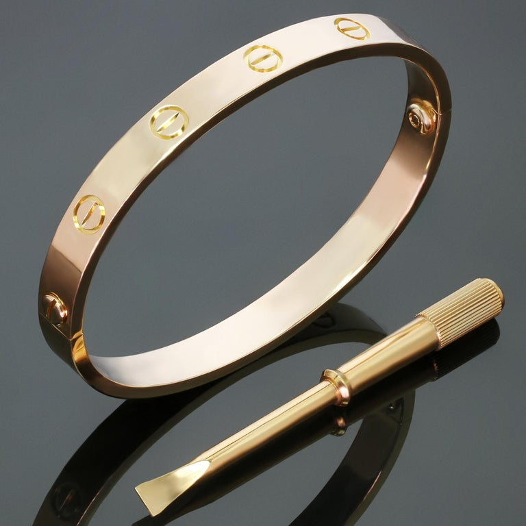 This classic Cartier bangle from the iconic Love collection is crafted in 18k rose gold and completed with the original screwdriver. This bracelet is a size 16. Made in France circa 2009. Excellent condition. Comes with original box and paperwork.