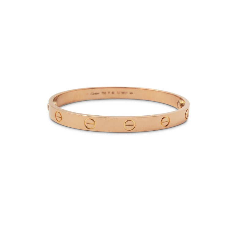 Authentic Cartier 'Love' bracelet crafted in 18 karat rose gold. Size 17. Signed Cartier, 750, 17, with serial number. The bracelet is presented with the original box, papers, and screwdriver. CIRCA 2010s.  Bracelet Size: 17 (17cm) Box: Yes Papers: