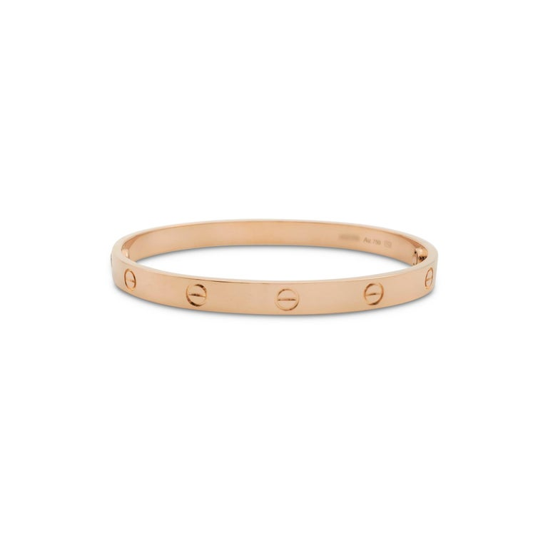 Authentic Cartier 'Love' bracelet crafted in 18 karat rose gold. Size 19. Signed Cartier, 17, Au750, with serial number and hallmarks. The bracelet is presented with the original box, papers, and screwdriver. CIRCA 2010s.  Bracelet Size: 19 Box:
