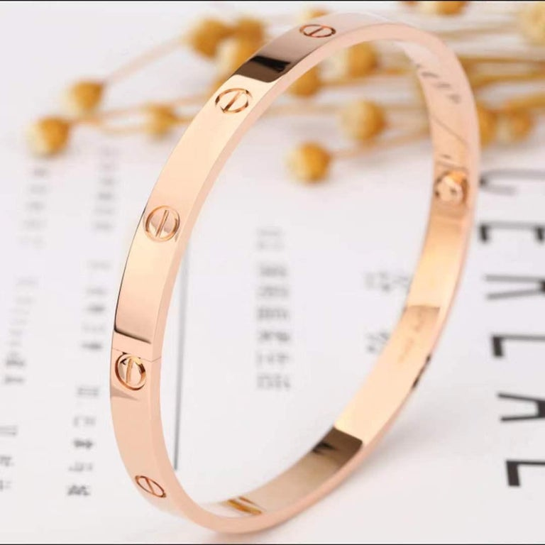 Authentic Cartier love bracelet crafted in 18K rose gold. Size 16. Signed Cartier, 16, Au750, with serial number. The bracelet is presented with the original screwdriver, box CIRCA 2010s.  Every piece we sell is 100% authentic guaranteed, in very