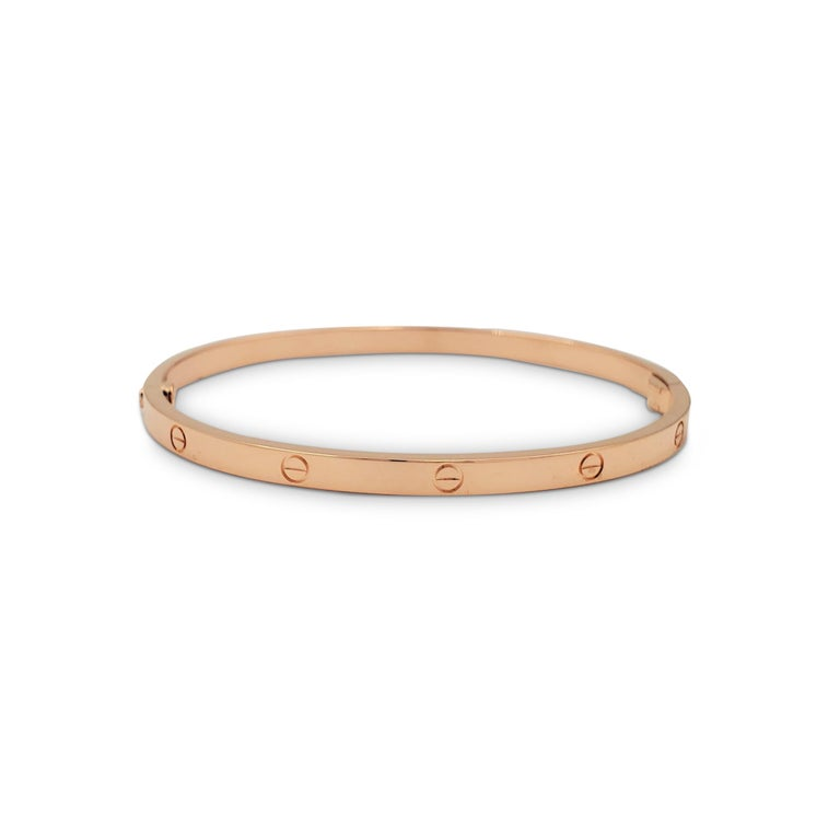 Authentic Cartier 'Love' bracelet crafted in 18 karat yellow gold. Size 17, US 6.75. Signed Cartier, 17, Au750, with serial number. The bracelet is presented with the original box, pouch, papers, and screwdriver. CIRCA 2010s.  Bracelet Size: 17 (17