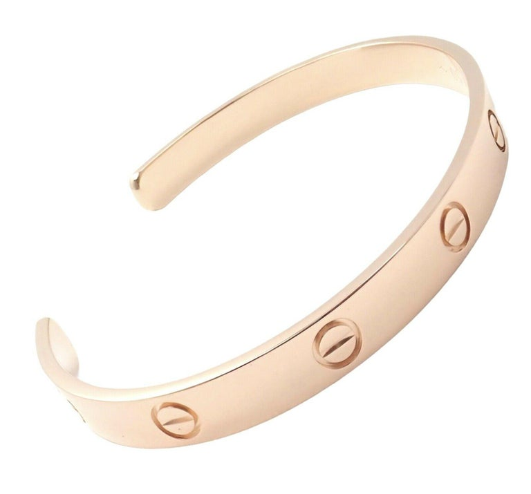 18k Rose Gold Cartier Love Open Cuff Bangle Bracelet. Size 19. Details: Length: 19cm Weight: 24.7 grams Width: 6.5mm Hallmarks: Cartier 19 EZ(*serial omitted*) AU750  *Free Shipping within the United States* YOUR PRICE: $4,350 Ti643tedd