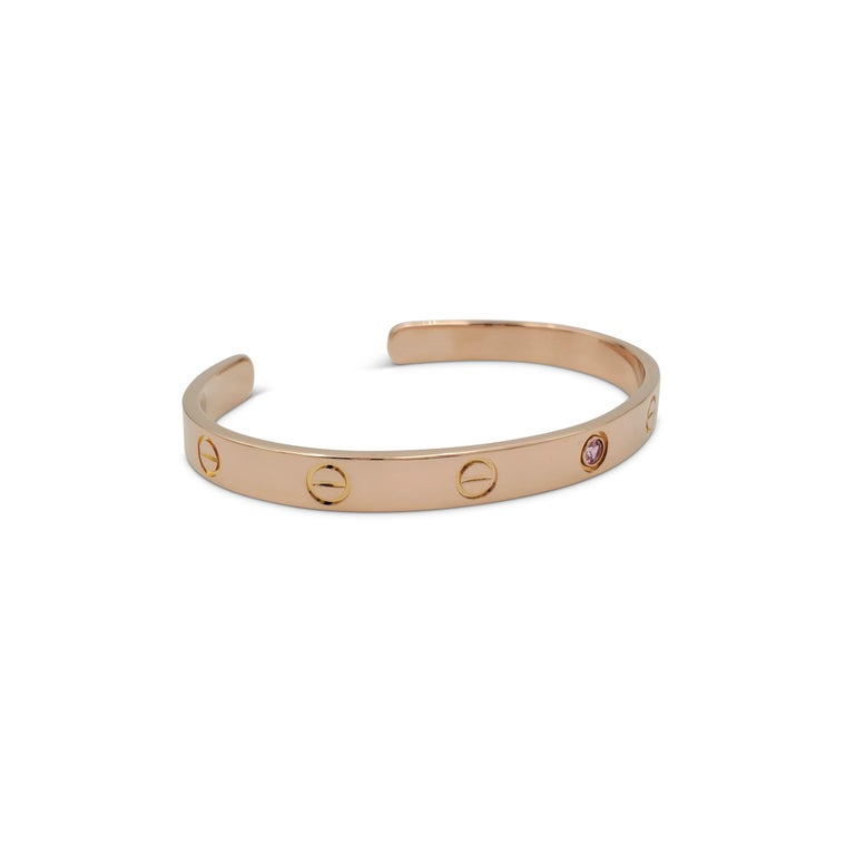 Authentic Cartier LOVE cuff bracelet crafted in pink gold and featuring 1 pink sapphire.  Size 18.  Signed Cartier, 18, 750, with serial number and hallmarks.  Bracelet is presented with original Cartier box, no papers.  CIRCA 2010s