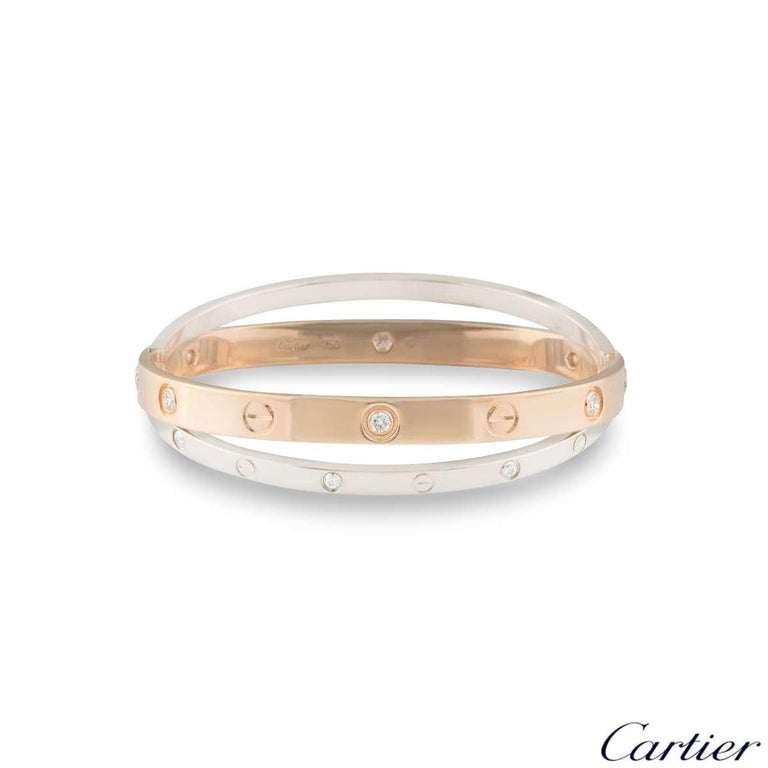 A stunning 18k double rose and white gold diamond bangle by Cartier from the Love collection. The rose gold bangle is set with 6 round brilliant cut diamonds and alternating screw motifs, interlinking with it is a white gold band on either side also