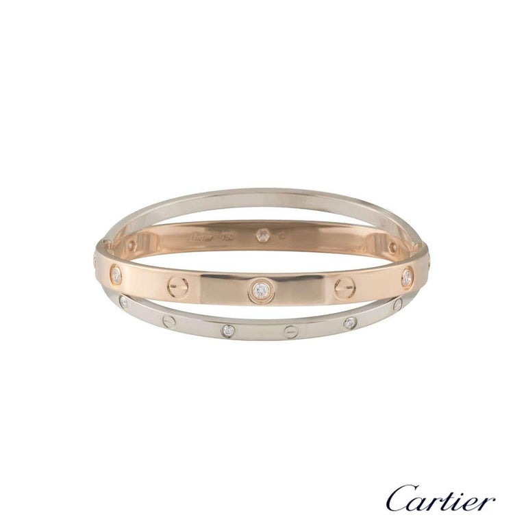 An 18k double rose and white gold diamond Love bangle by Cartier from the Love collection. The rose gold bangle is set with 6 round brilliant cut diamonds and alternating screw motifs, interlinking with it is a white gold band on either side also