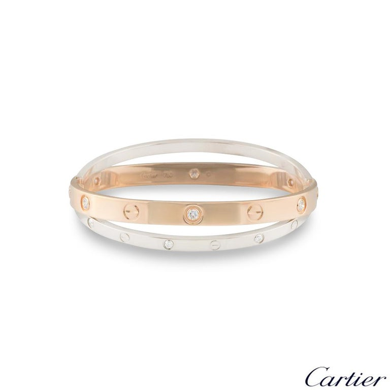 An 18k double rose and white gold diamond bangle by Cartier from the Love collection. The rose gold bangle is set with 6 round brilliant cut diamonds and alternating screw motifs, interlinking with it is a white gold band on either side also