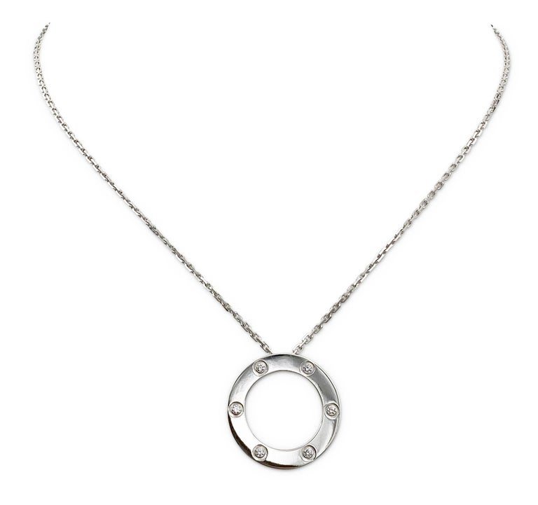 Authentic chain and ring charm necklace from the Cartier Love collection. Made in 18 karat white gold and oval link chain with a half-inch round ring and screw top motifs set with 6 round brilliant cut diamonds (F color, VS clarity) of approximately