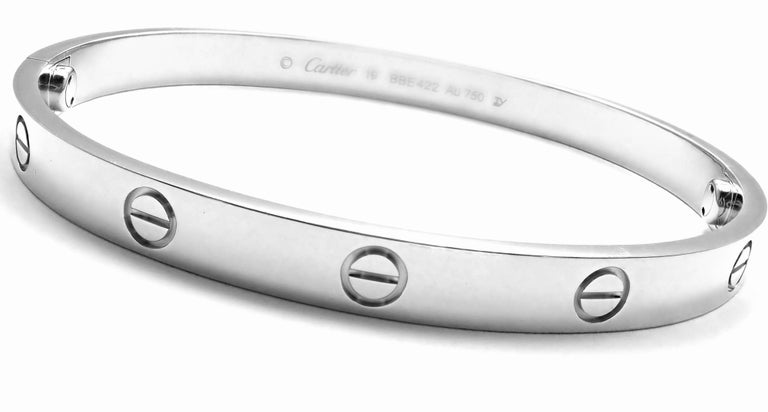 18k White Gold Love Bangle Bracelet by Cartier. Size 19.  This bracelet comes with Cartier certificate, Cartier box and Cartier screwdriver. This bracelet has the new screw system. Details: Size: 19  Weight: 38.1 grams Width: 6.5mm  Hallmarks: