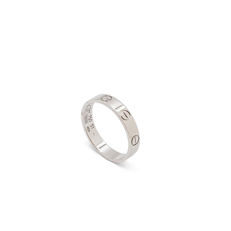 Authentic Cartier 'Love' wedding band crafted in 18 karat white gold. Signed Cartier, 750, with serial number. Ring size 51 (US 6). The ring is presented with the original box, no papers. CIRCA 2010s.  Ring Size: 51 (US 6) Box: Yes Papers: No