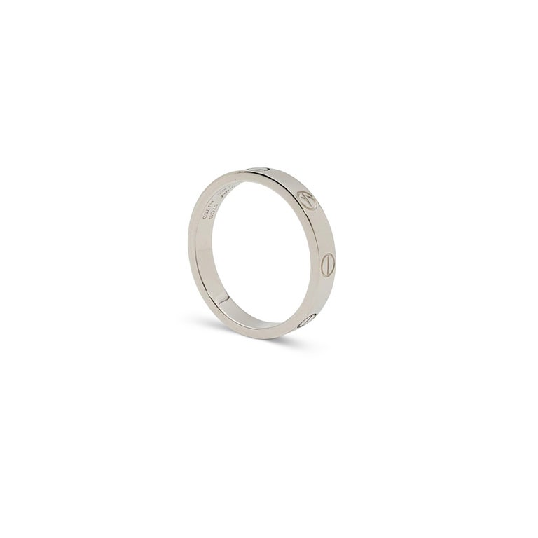 Authentic Cartier 'Love' wedding band crafted in 18 karat white gold. Signed Cartier, 750, with serial number. Ring size 57 (US 8). The ring is presented with the original pouch, box, and papers. CIRCA 2010s.  Ring Size: 57 (US 8) Box: Yes Papers: