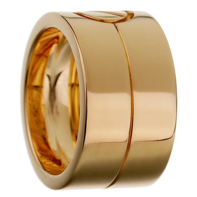 A circa 1990s yellow gold Cartier love ring showcasing the iconic motif in 18k yellow gold, the ring measures a size 5.
