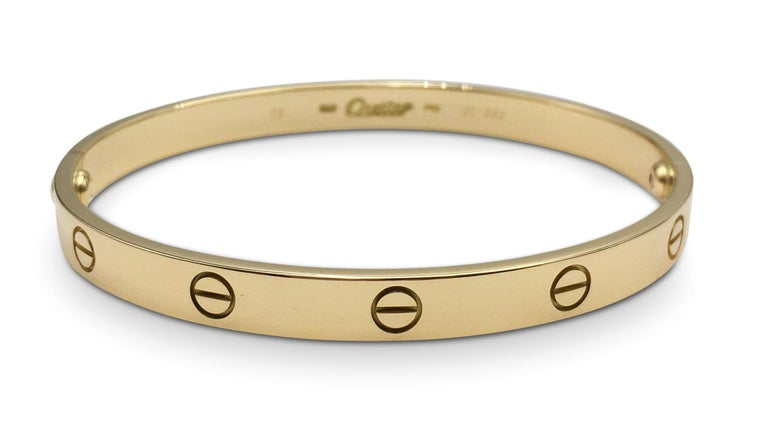 Authentic Cartier 'Love' bracelet crafted in 18 karat yellow gold. Size 19. Signed Cartier, 750, with serial number. The bracelet is presented with the original screwdriver, no box or papers. CIRCA 2000s.