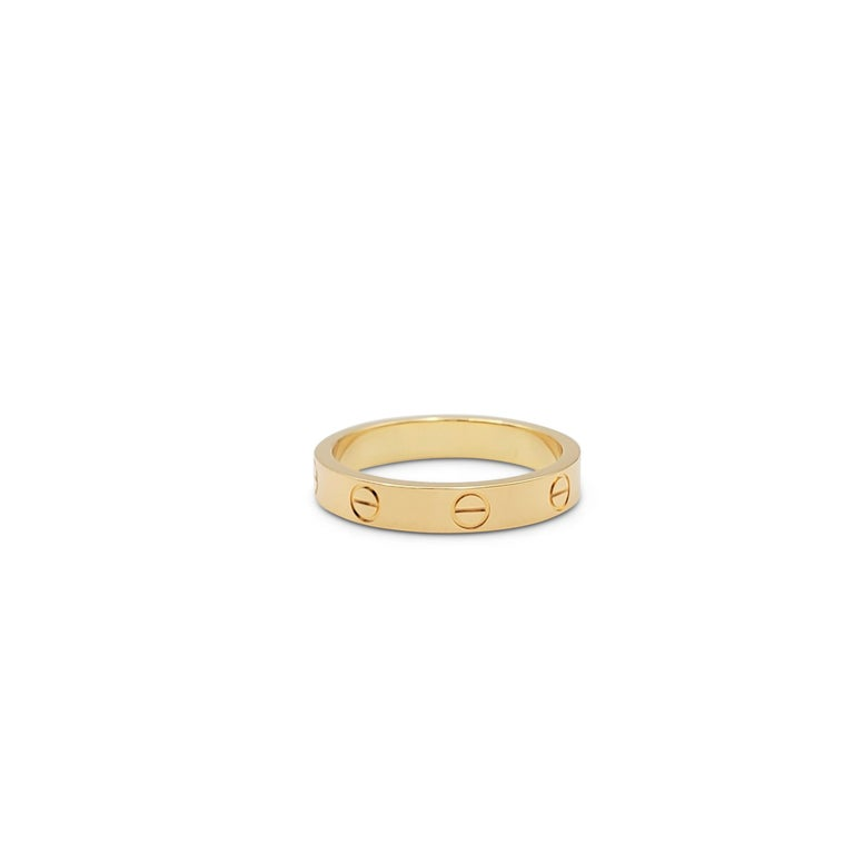 Authentic Cartier 'Love' wedding band crafted in 18 karat yellow gold. Signed Cartier, 750, with serial number. Ring size 57 (US 8). The ring is presented with the original pouch, box, and papers. CIRCA 2010s.  Ring Size: 57 (US 8) Box: Yes No: Yes