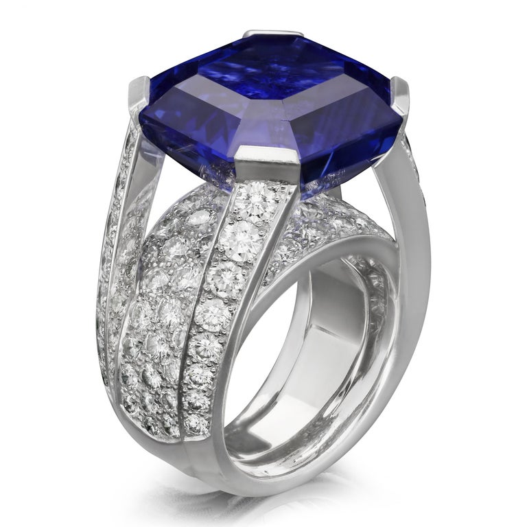 Description A magnificent sapphire and diamond ring by Cartier c.2000s, centred with a beautiful octagonal blue Ceylon sapphire weighing 27.04ct set to each corner with a flat claw in an open gallery leaving the stone open to the light and raised