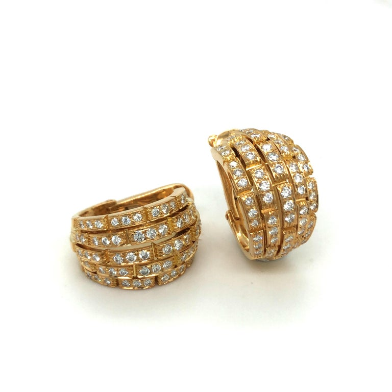 Classy pair of 18 karat yellow gold and diamond Maillon Panthère half-hoop earrings by Cartier, 1999. Of brick-link design, set with 120 brilliant-cut diamonds totalling circa 2 carats, these earclips have fine studs which provide additional