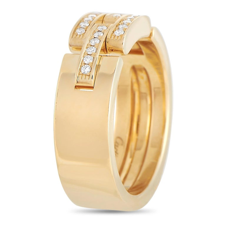 This Cartier Maillon Panthere 18K Yellow Gold Diamond Ring will suit a strong, independent woman who knows her worth. On a 6mm wide band in yellow gold are three glistening links pave-set with sparkling diamonds. Designed with a powerful and