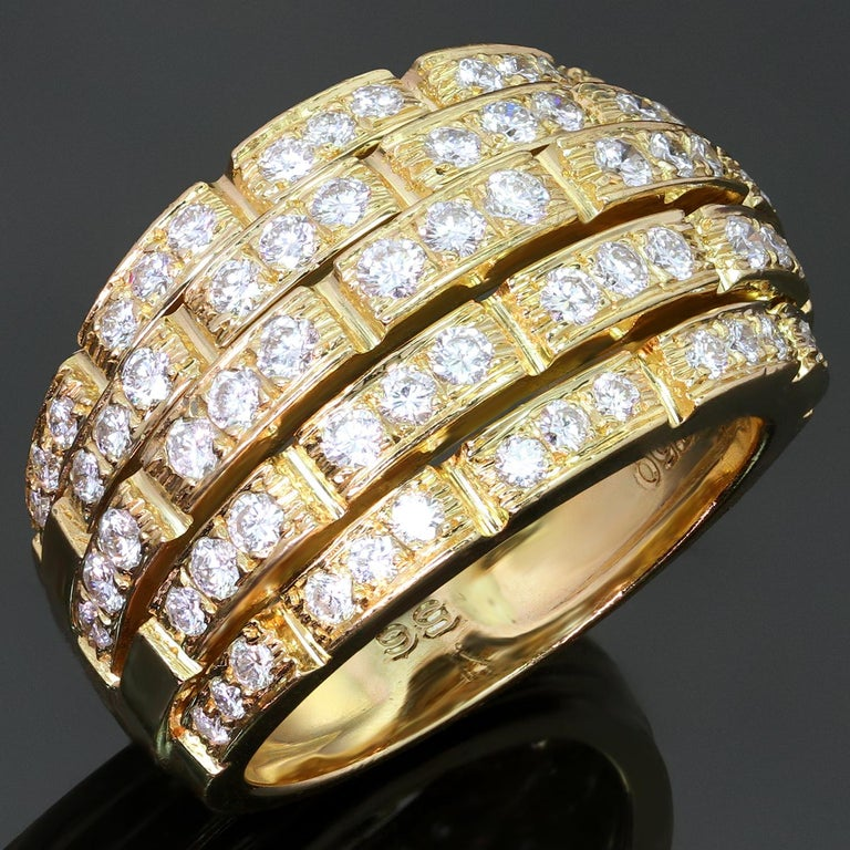 This stunning band from Cartier's Maillon Panthère collection features a 5-row bombe design crafted in 18k yellow gold and set with brilliant-cut round F-G VVS1-VVS2 diamonds of an estimated 2.27 carats. Made in France circa 1980s. Measurements: