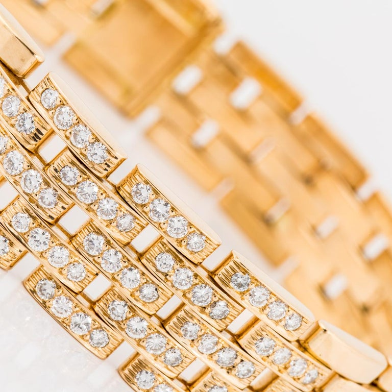 Cartier Maillon Panthère five-row gold link bracelet in 18K yellow gold with round brilliant-cut diamonds. The center portion has 19 links that are pavé-set with four diamonds each totaling 1.88 carats of diamonds, F-G color, VVS-VS clarity. The