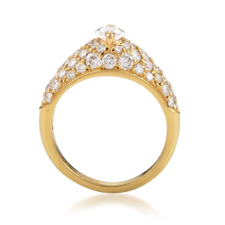 Leading up to the stunning central marquise diamond weighing 0.60 carats, lustrous smaller diamonds totaling 1.25 carats are arranged neatly upon the fabulously radiant 18K yellow gold in this gorgeous ring from Cartier. Band Thickness: 3 mm Ring
