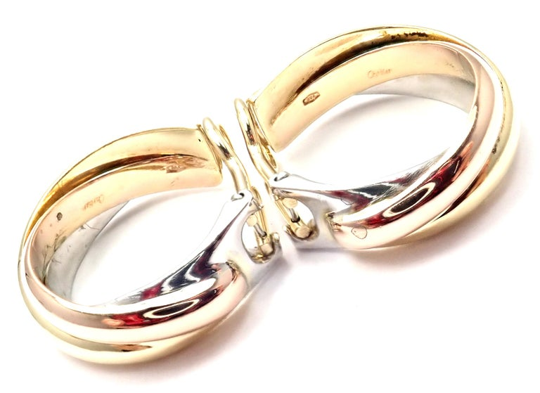 18k Tri-Color (Yellow, White, Rose) Gold Medium Size Trinity Hoop Earrings by Cartier.  These earrings are for non pierced ears, but they can be converted by adding posts. Details:  Measurements: 24mm x 22mm x 7mm Weight: 18.1 grams Stamped
