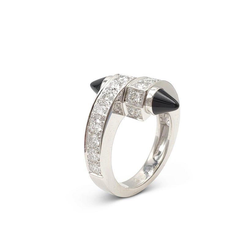 Cartier 'Menotte' White Gold Diamond and Onyx Bypass Ring In Excellent Condition For Sale In New York, NY
